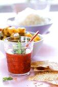 Strawberry & mango chutney in jar by chicken curry & rice