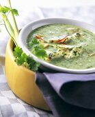 Spinach and coconut soup with chicken breast
