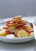 Potato and radish salad with diced tomatoes