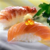 Nigiri sushi with salmon and with shrimps