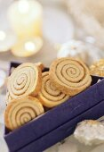Sweet pastry cinnamon snails in a blue box