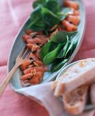 Marinated salmon with spinach salad