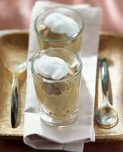 Cappuccino mousse with cream topping in glass