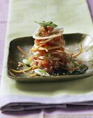 Spicy salmon tartare with rice crackers