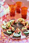 Pumpernickel with herring tartare; party decorations