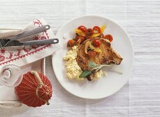 Pork chop with tomatoes and polenta