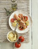 Salmon trout with tomatoes and mashed potato