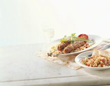 Mince kebabs, pilaw and tomato salad (Turkey)