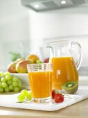 Multivitamin juice in glass and jug
