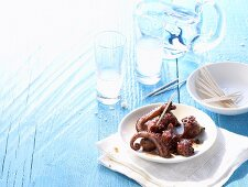 Octopus marinated in red wine, ouzo (Greece)