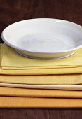 White plate with yellow stripes on yellow napkins