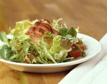 Salad leaves with sheep's cheese wrapped in bacon