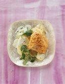 Breaded scallop on potato salad