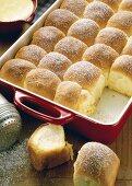 Buchteln (baked yeast dumplings) in baking dish, custard