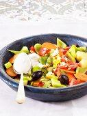Vegetable salad with tahini (sesame paste)