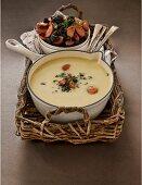 Potato soup with chorizo and smoked olive salsa