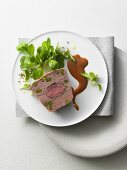 Venison terrine with rosehip sauce and lambs lettuce