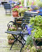Inner courtyard in town with flowers and garden furniture