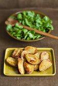 Baked potato halves with fleur de sel and corn salad