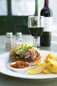 Steak sandwich with garlic dressing and home-made potato wedges