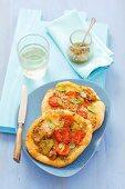 Two small tuna pizzas with pesto and mozzarella