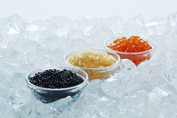 Lumpfish roe, pike caviar and salmon caviar in glass dishes