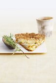 A piece of apple tart with agave and rosemary
