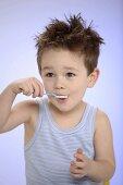 Small boy eating yoghurt
