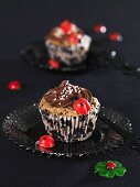 Chocolate muffins with ladybirds for New Year's Eve