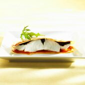Cod with tapenade between sheets of lasagne