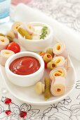 Ham and cheese rolls with ketchup and mayonnaise