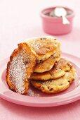 Raisin pancakes with icing sugar