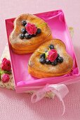 Heart-shaped cheesecakes with blueberries
