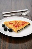 Omelette filled with olive paste