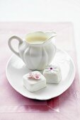 Petit fours and cream jug