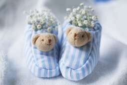 Blue and white baby shoes with gypsophila