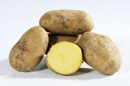 Several potatoes (variety 'Heideniere'), whole and one half