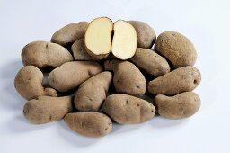 Many potatoes (variety 'Kepplestone Kidney'), whole and halved