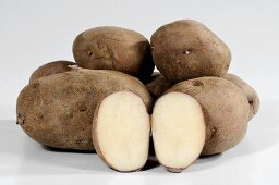 Potatoes (variety 'Edzell Blue'), whole and halved