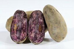 Potatoes (variety 'Blaue Elise'), whole and halved
