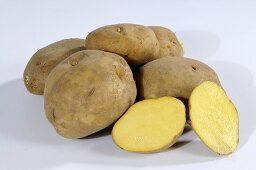 Several potatoes (variety 'Ackersegen'), whole and halved