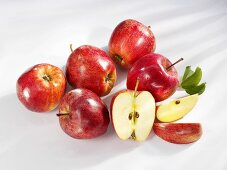 Several red apples (whole, halved and wedges)