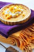 Passion fruit tart with mango and cream