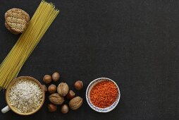 Still life with lentils, nuts, rice, spaghetti and crackers