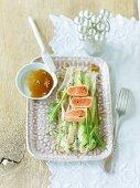 Salmon tataki on cucumber salad