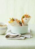Raw carrot and ham wraps and hot orange gomasio