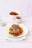 Lamb fillet on spiced tomatoes