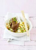 Asian cabbage salad with strips of steak