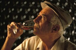 A man tasting wine (France)