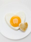 Heart-shaped fried egg and toast